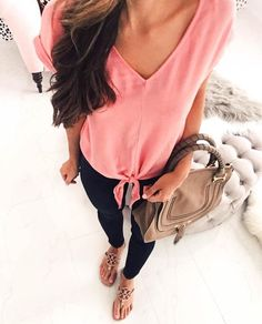 Pink top with tied waist.
