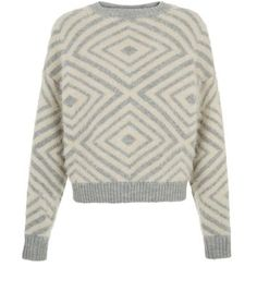 """Add a vintage feel to a winter wardrobe with this grey fluffy patterned jumper - wear with grey ripped knee skinny jeans and cut out flats.- Fluffy design- Simple long sleeves- Rounded neck- All over pattern- Cuffed hem- Casual fit- Model is 5'8""""/176cm and wears UK 10/EU 38/US 6"""