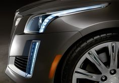 The all-new 2014 Cadillac CTS midsize luxury sedan with Cadillac's signature bold vertical lighting elements – including LED front signature lighting detail – evolve with headlamps that flow up and with the hood line.