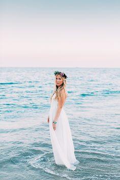Stunning boho beach bride. Love her dress and flower crown.