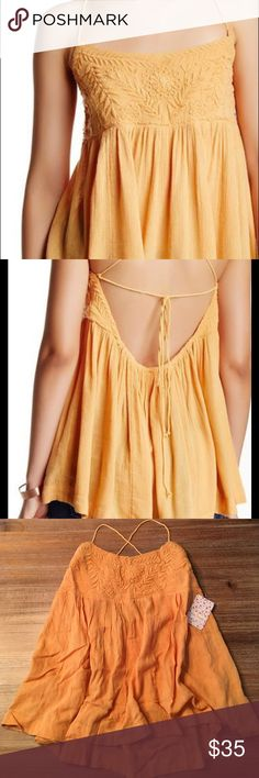 ✨NWT✨ Free People   Mango Blackbird Blouse Brand new, never worn. Flowy tank with embroidered lace detailing & self-tie string back. Beautiful. Extremely soft - cotton/rayon blend! Free People Tops Tank Tops