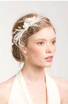 Feather adorned birdcage veil