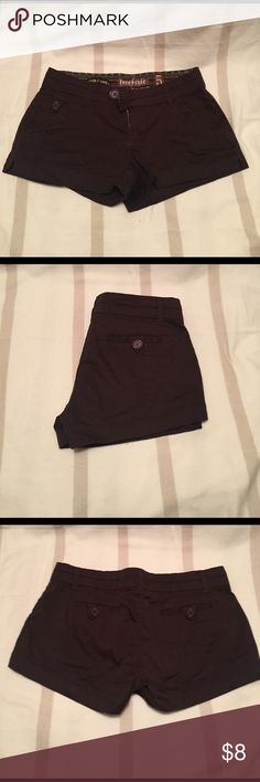 Button pocketed brown shorts Super cute and super short- brown shorts for summer. 98% cotton and 2% spandex Shorts