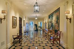 As you step off the private elevator and through the front door, the grand gallery with its elegant black-and-white marble flooring creates a stately entrance hall.