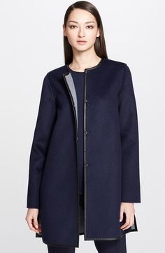 St. John Collection Reversible Coat with Leather Trim at Nordstrom.com. Smooth black-leather trim outlines a cleanly styled coat cut from a warm wool blend. The polished style reverses from navy to grey for ultimate versatility.