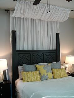 bed canopy-- gives the wall some visual interest without putting frames above bed. Does the canopy have to match the bedroom curtains?