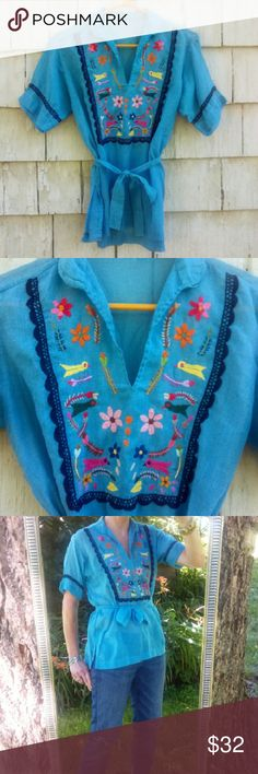 """Vintage Embroidered Bohemian Shirt This true vintage, embroidered, lightweight woven cotton (I think, no material tag), bohemian / hippie style shirt is not only a rare find, it is also fabulous and currently stylish! Very Free People style! Optional waist tie, or you could use it as a belt of headband. Slits on each side. Best suited for size xsmall - small. Chest measures 19 1/2"""", side slits are 6"""" long, and total length is 23"""" long. Great vintage condition, some slight extra fuzziness to…"""