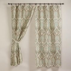 These too!  Porcelain Victoria Jute Wood Ring Curtain - World Market.  If only I had some unadorned windows...