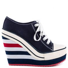 I see London I see France, fall in love with these at first glance!  The Rock and Candy London features a rich navy blue canvas upper with lace up vamp and rubber sneaker details.  A striped 5 inch wedge and 2 inch platform complete this everyday fresh style.