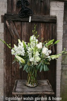 Floral arrangement feat. white roses, hydrangeas, and lilies