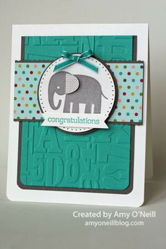 Bold colors adorn this stunning Baby Congratulations card by Amy O'Neill.  For a deep green/blue cardstock color, try Core'dinations Aegean found at www.cardstockshop.com.
