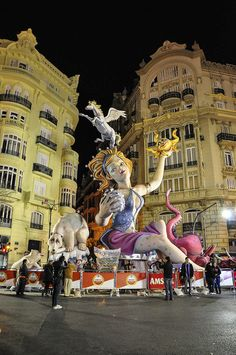 Giant Falla Valencia City Spain .Valencia Spring Festival.  I went here with my friend Caroline.  It was amazing and crazy!  They make these beautiful giant sculptures and then light them on fire at midnight and watch them burn and topple.