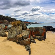 Spiky Beach on Tasmania's East Coast. This oddly named beach gets its name from the rocks that seem to spike out of the sand. It also not far from Spikey Bridge which is famous for the field stones that are laid vertically giving it a spikey appearance. Image Credit: lifecatchme #discovertasmania #tasmania #beach #spikybeach