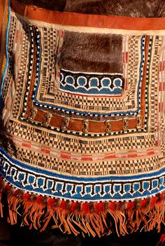 A detail showing the front of an E'ven woman's traditional apron. Koryakia, Kamchatka, Siberia, Russia