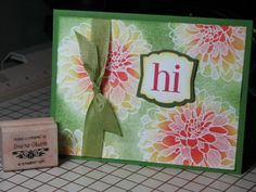 handmade greeting card ... embossed resist technique ... big gorgeous dahlia embossed in white and sponged with red and orange ... green in open spaces ... pretty card ... Stampin' Up!