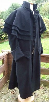 A remake of a garrick coat worn by men with multiple cape collars and a high neckline with big cuffs.