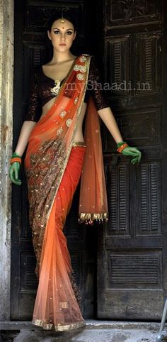 I don't get the green gloves but the sari and blouse are scrumptious.