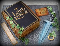 All edible fondant decorated cake .A sponge book cake and a fondant glowing sword Pretty Cakes, Beautiful Cakes, Amazing Cakes, Cupcakes, Cupcake Cakes, Crazy Cakes, Fancy Cakes, Hobbit Cake, Cake Paris