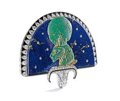 Louis Cartier, Egyptian Revival brooch, 1923.  Lapis lazuli, diamonds, enamel, platinum, gold. Designed around a faience, 730 BC. Egyptian fan, or flabellum, centering a bust of the goddess Sekhmet, depicted with a solar disc and a Uraeus on her head. Source: Sotheby's