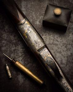 A Pair of .410 round body shotguns by David McKay Brown. Creative Arts engraving.
