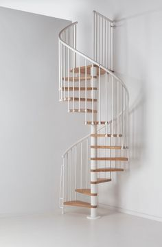 Fontanot Oak 70 Spiral Stair Kit -- Available in 3 diameters: 1100mm, 1300mm & 1500mm. Standard kit complete with 12 treads + landing tread to suit a height up to 3110mm. Unit has solid varnished oak treads, steel centre column and a fixed steel balustrade (white PVC handrail with aluminium core) positioned on the spiral's outer edge. Metal-work is only available powder coated in white. Optional Upper Floor Balustrade and Riser Bars are available. # From £1,420.00 + VAT