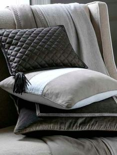 Quilted Leather Chocolate Cushion | Desert White Cushion with suede panel | Liquid Pewter Cushion with windowpane metalwork embroidery | Cashmere and Suede Throw with suede fringing. All available from www.delecuona.com