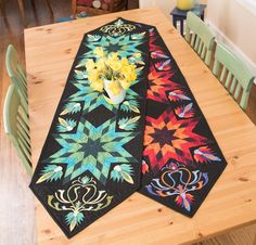 """Sew a stylish addition to your decor with the Lotus Palette Table Runner Kit! You'll receive a pattern and Jinny Beyer Palette fabric to complete this striking, 18"""" x 73"""" runner. Use Jinny's signature foundation paper-piecing and appliqué techniques to bring this beauty to life!"""