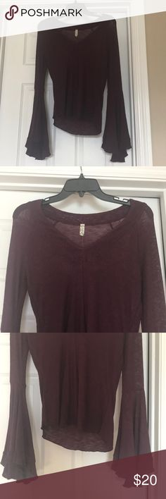Plum sheer Free People Sweater Beautiful Plum color. Sheer. Can wear fun tanks or bra beneath. Amazing bell sleeve. Never been worn. Love it but not my color. Have in Black for myself. 😁 Very soft...thin and great for layering. Free People Sweaters V-Necks