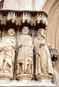 Photo about An image of three stone statues of saints on the outside of the Cathedral in Tarragona Spain. Image of moses, three, image - 80725841