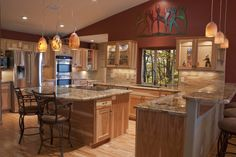 Luxury kitchen with a unique layout and variety of colors and finishes.