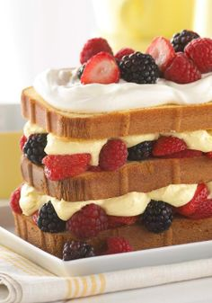 """Berry Bliss Cake – """"Professional,"""" """"a winner,"""" """"awesome""""—fans rave about this luscious take on shortcake that's a towering beauty of fresh berries, creamy filling and summer delights."""