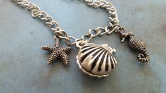 Check out this item in my Etsy shop https://www.etsy.com/listing/236379660/beach-necklace-secret-keeper-magnet-clam