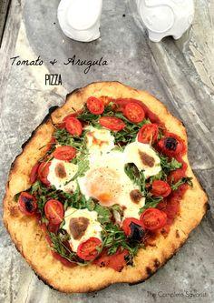 Tomato and Arugula Pizza with fresh mozzarella and an egg