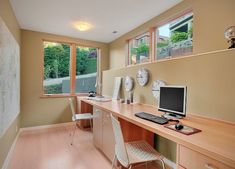 modern-study-area-for-kids-with-desk-along-the-wall-and-big-windows.jpg