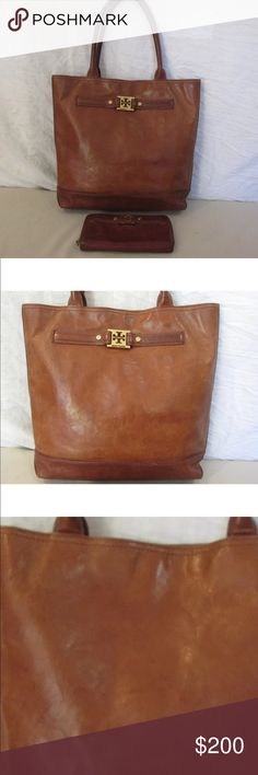 Tory Burch Tote and Wallet Tory Burch natural tan leather tote. Bag is spacious, on the interior there is one large main compartment, lined in fabric, back zipper pocket, two back pockets and a mirror. This bag is pre owned in good preowned condition with no tears or holes. There are some ink stains on the inside and scuffs on the exterior, so please look at pics. The zip around leather wallet is a darker tone of tan and has credit card holder, coin section. The wallet is missing the leather…