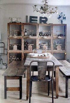 DIY Rustic room - dining room table and benches love the rustic look paired with the old metal chairs!
