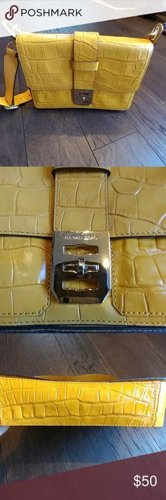 Michael Kors Handbag Re-posh MK purse. It was love at first site but just never used it. Help me find it a good home that will love it. Great color for the fall and spring. Its in great condition, does show marks on the hardware. Michael Kors Collection Bags