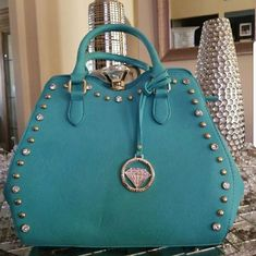 Traci Lynn Diamond Chic Turquoise Bag Traci Lynn Diamond Chic Turquoise Purse . I didn't list this purse as new because I used it as a display. The bag has original sales tags and is in really good condition. You can also shoponline at  www.tracilynnjewelry.net/cashgray Bags Shoulder Bags