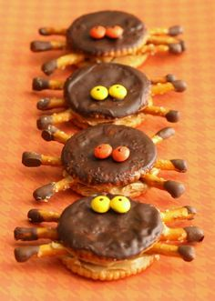 ritz crackers with peanut butter in the middle and chocolate on top and mnms as eyes. add mini pretzle rods for the legs