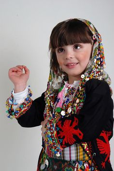 little girl wearing traditional albanian costume