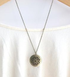 Brass Filigree Locket Necklace | Give an outfit a classic, romantic feel with this brass locket... | Necklaces