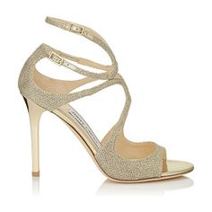 On SALE at 30% OFF! Lang gold lamé glitter fabric sandals by Jimmy Choo. From red carpets to dance floors these strappy sandals are iconic Jimmy Choo. The delicate straps beautifully encase ...