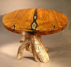 This round dining table is made of Alligator juniper, just gorgeous.