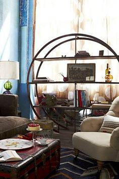 Kansai Bookcase | Anthropologie.eu  I have this circular shelf in my sunroom, but I need to figure out what to put on it...but the shelf still rocks