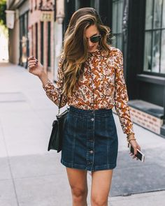 I love this concept--the blouse with the high waisted skirt--but I could do without a denim skirt. I love the blouse though  (material, pattern) except I'd take it in a different color (not a fan of orange)