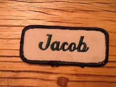"Jacob, An off white work shirt patch that says ""Jacob"" in green script with green border. on Etsy, $2.00"