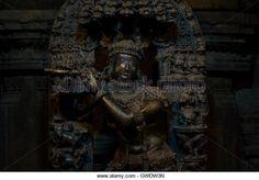 Sculpture of the Hindu god Krishna playing a flute at Chennakesava Temple,Somanathapura,Karnataka, India, Asia - Stock Image