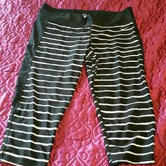 Nike track pants Black and white stripped dry fit Capri track pants. Excellent condition. Worn once Nike Pants Track Pants & Joggers