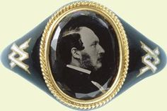 Mourning ring showing a photograph of Prince Albert.  This ring was commissioned and worn by Queen Victoria. When Albert died in 1861, his widow Queen Victoria entered into a state of mourning which lasted for the remainder of her life.  The Queen expected anyone who set foot in her court to observe mourning for her departed husband and her socially conscious upper and middle class subjects soon followed suit, making mourning into a fashion in its own right.