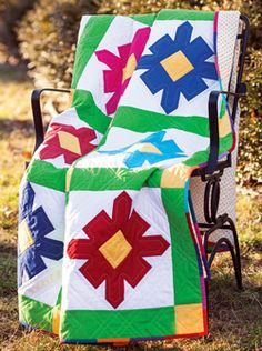 Washington Island Poppies is the latest in Marianne Fons series of quilts inspired by one of her favorite places on earth, Washington Island, Wisconsin. Every spring, bright wild poppies dot the island farm fields.